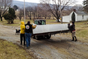 Hauling the new cheese vat down from the barn to the creamery was the easy part