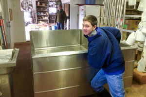Austin thought he could push our old cheese vat out all by himself
